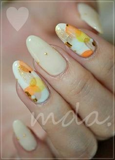 Awesome skittle mani!!!  This reminds me of watercolour, in autumn hues over a beautiful off-white!  And the tiny gold studs are just darling!!!