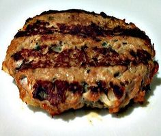 A turkey burger with an Asian spin that includes garlic, ginger, soy sauce, mushrooms and water chestnuts for a little crunch. There's just a little cayenne pepper, but you can always add more if you like spicy food. Spicy Recipes, Grilling Recipes, Great Recipes, Favorite Recipes, Healthy Recipes, Chicken Recipes, Grilled Turkey Burgers, Turkey Burger Recipes, I Love Food