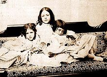 Alice, (right, with sisters c 1859,photo by Lewis Carroll) was the 4th child of Henry Liddell, Dean of Christ Church, Oxford, and his wife Lorina Hanna Reeve. She had two older brothers, Harry (born 1847)  Arthur (born 1850, died of scarlet fever in 1853), and an older sister Lorina (born 1849). She also had six younger siblings, including her sister Edith (born 1854) with whom she was very close.