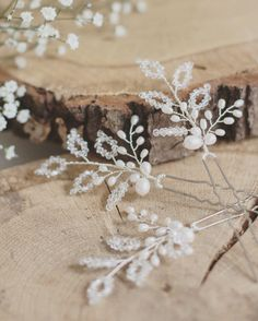 Beautiful hair pins for the bride or bridesmaids made with sparkling Swarovski crystals and freshwater pearls. This listing is for a set of 3 pins. Please message if you require a different amount and a custom listing will be set up for you. These pins are made with silver plated wire on a silver plated pin. They are available in gold or rose gold upon request.  The pins measure approximately 5 in length (including the pin) and 2 in width.  The pins are made to order and supplied boxed.