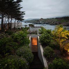 Concrete painter's studio by Felipe Assadi nestles into a rocky hillside on the Chilean seafront