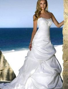 I love the pull ups, sweetheart neckline, and lace up back. Maybe this could work for a summer wedding since it is recommended for the beach.