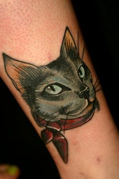 Realistic cat tattoos usually look so bad, but this cartoony one is cool.