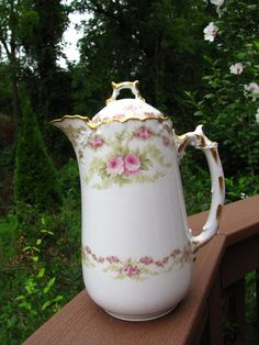 This auction for antique porcelain coffee, chocolate pot, made by Limoges , Elite, France, circa 1900's, marked ( green and red marks). Thecoffee potdepicting beautiful roses .
