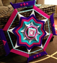 Hi guys! Just dropping by to show you my latest mandala creation. I made this one for my niece, Cierra. I picked out the colors to represent her bubbly personality and caring spirit. Yarn Crafts, Diy And Crafts, Arts And Crafts, God's Eye Craft, Weaving Designs, Gods Eye, Weaving Art, Nature Crafts, Mandala Art