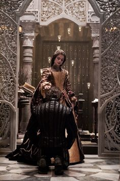 Queen Helene dubbing her son a knight, years before Lexa's birth, before losing him in a battle, becoming cruel, and putting the kingdom first after being told that's how she should move on.