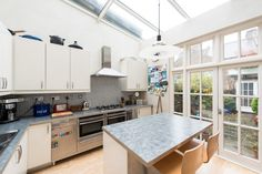 This massive four-bedroom converted warehouse offers wonderful open-plan living spaces, an extraordinary master suite, a garden, roof terrace and integral double garage. The house was refurbished a number of years ago by the interior designer Lynne Morgan. Its modest Victorian frontage provides little idea of the voluminous interior within. Upon entering, there is a generous […]
