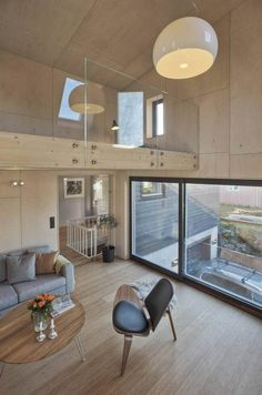 angular-home-addition-with-plywood-lined-interior-8-balcony.jpg