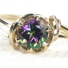 Natural Fire Mystic Topaz Gemstone Ring    Lovely and dainty 6mm round Mystic Topaz Faceted Gemstone hand sculpted in the finest Jeweler's 14K Rolled Gold custom designed setting.      Stone displays
