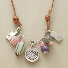 """TRADE BEAD TREASURE NECKLACE--Antique trade beads mingle with sugilite, cherry quartz and sterling silver charms that bob between leather knots. Further up, sliding knots adjust the length. Sundance exclusive handcrafted in USA. 16"""" to 24""""L."""