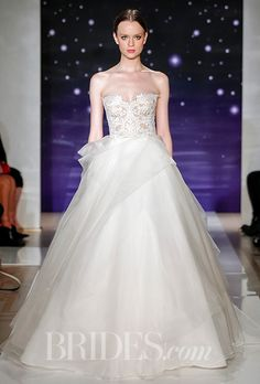Brides.com: . Silk organza ball gown with an embroidered strapless bodice and bustled skirt detail, Reem Acra