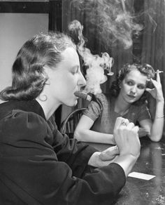 """LIFE made a point of noting that during poker Joan Thornwaite (left) """"chewed her cigar fitfully"""" and """"failed to get sick."""""""