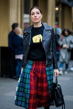 A satchel and tartan skirt might sound a bit like a school girl's uniform, but when combined with a leather biker jacket and graphic sweater, it's street style heaven.