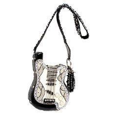 Graceland Handbag by Mary Frances. Elvis fans everywhere, this bag is for you! It is after all, named after the King's homestead.