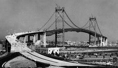 (1963)^** - The Vincent Thomas Bridge nears completion between San Pedro and Terminal Island.