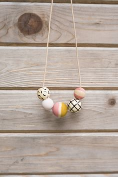 From Anna Joyce Design: These hand painted, wooden bead necklaces are a playful way to add color and pattern to your wardrobe. They are light and comfortable and a look great worn alone, or stacked. I hand paint and embellish each bead by hand in