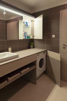 Strakke badkamer, mooie kleuren. Wasmachine mooi ingebouwd