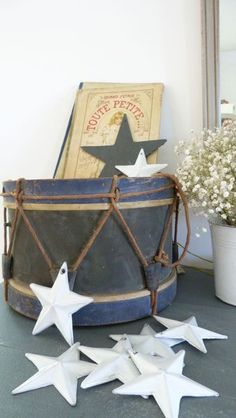 Stars and Poster wall art. A vintage drum as table/storage.