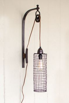 """The Jitterbug-Wire Cylinder Wall Lamp With PulleyProduct Dimensions: 15"""" x 5"""" x 26""""tAll Painted Fox Lighting is Special Order and will ship 4-6 weeks from date of order. If you need your lighting sooner, please contact us and we will do the best we can to get your light to you as soon as possible. Special Order lighting may be subject to a 25% restocking fee."""