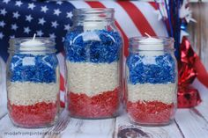 4th of July Mason Jar Candles made out of rice that is dyed red and blue.  So easy that your kids can help you make these!