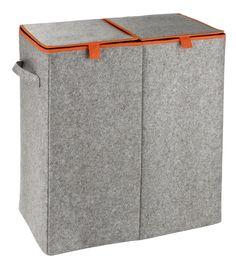 Der große Wäschesammler aus hochwertigem Filz in grau mit orangefarbenen Rand ist dezent und wirkt trotzdem modern. Die zwei getrennten Fächer ermöglichen eine optimale Vorsortierung der Wäsche. Für € 39,99 bei kloundco.de.