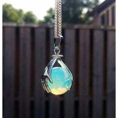 Opal crystal ball necklace, crystal necklace, moonstone, opalite,... ($12) ❤ liked on Polyvore featuring jewelry, necklaces, moonstone pendant necklace, opal pendant necklace, moonstone pendant, pendants & necklaces and crystal necklace