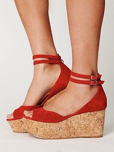 Stunning suede open-toe wedge platform with double adjustable ankle straps. Cork wedge