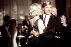 Still of Kim Basinger and Robert Redford in The Natural
