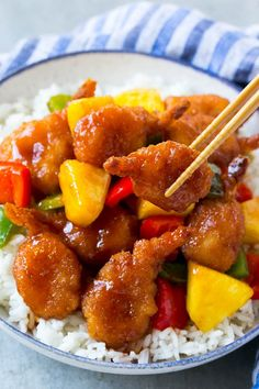 This sweet and sour shrimp recipe is made with crispy shrimp, colorful veggies and pineapple, all tossed in a homemade sweet and sour sauce. The perfect quick and easy summer dinner that's perfect for entertaining!