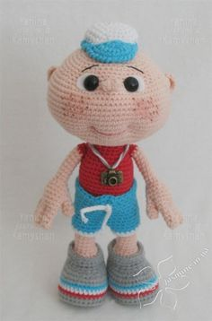 Kid named Gosha, crocheted toy