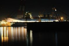 Maersk Line Triple E ship construction at night.
