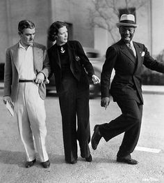 LOOK CAREFULLY AND FOLLOW IF YOU CAN…  Bill 'Bojangle' Robinson  with producer George White and Eleanor Powell