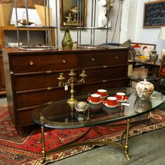 ChancesAreATL offers Vintage goodies at incredible prices at HighlandRowAntiques in Atlanta. Including this glamorous brass and glass LaBarge oval coffee table with cloven hoof feet, and this walnut 7 drawer dresser with unusual brass hardware.  Follow on IG for new arrivals. ✌️