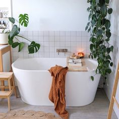 Oversized white tub with matching white subway tile makes this an inviting bathroom. And of course, add plants for a touch of green and you have a dreamy bathroom. whitetilebathroom minimalistbathroom Photo by 538180224220154543 White Bathroom Tiles, Bathroom Plants, Modern Bathroom, Master Bathrooms, Bathroom Mirrors, Bathroom Cabinets, Shower Tiles, Marble Bathrooms, Luxury Bathrooms