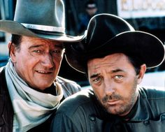 John Wayne & Robert Mitchum from:   El Dorado (1966)  Cole Thornton (John Wayne), a gunfighter for hire, joins forces with an old friend, Sheriff J.P. Hara (Robert Mitchum).  Together with an old Indian fighter (Arthur Hunnicutt) and a gambler (James Caan), they help a rancher and his family fight a rival rancher that is trying to steal their water.