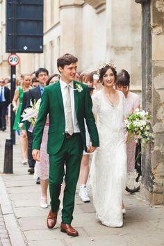 Groom in emerald green suit holding bride's hand @myweddingdotcom