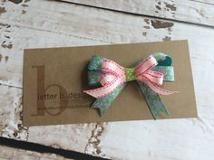 Double Stack Bow on a Claw Alligator Clip: Turquoise Pattern; Pink Stitch and Lime Dot by letterbdesigns on Etsy https://www.etsy.com/listing/243504723/double-stack-bow-on-a-claw-alligator