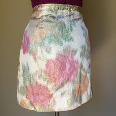 """Shimmering floral skirt I love this!!! Bought it hoping it would fit. Unfortunately it doesn't :( beautiful shimmering fabric with watercolor flowers and bold brass zipper up the back. Mint condition. Pair with a while blouse or gold... The possibilities are endless! Size 10. 16.5"""" long   No swaps   #handm #skirt #floral #floralskirt #gold #zipper #shimmering #size10 #size10skirt #sizel #large #summer #summerskirt #formal #semiformal #weartowork #dressup H&M Skirts"""