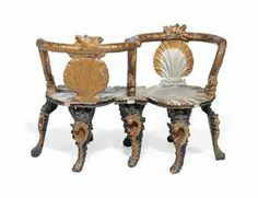 A VENETIAN SILVERED AND GILT DECORATED 'GROTTO' CONVERSATION SEAT LATE 19TH/ EARLY 20TH CENTURY Each back and seat carved as a scallop shell, the arms and top rails carved as intertwined dolphins, on conch-shell carved legs 46 in. (117 cm.) wide