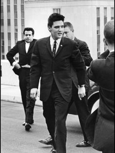 Arriving at the State Capitol Building in Tennessee for a speaking engagement, after which he was presented with awards and accommendations for his many charitable contributions. December 1961.
