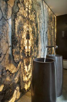 "Backlit stone feature wall, ""cigar"" stone basin, mirror splash back--big statement powder room! Bathroom Sets, Modern Bathroom, Stone Bathroom, Marble Bathrooms, Stone Feature Wall, Wall Design, House Design, Stone Basin, Stone Bowl"