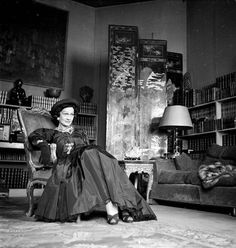 Coco Chanel in black taffeta dress and hat in her apartment on the Rue Cambon, 1950 photo Walter Carone, Paris