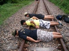 Train track planking Planking, Train Tracks, Dumb And Dumber, Hiking Boots, Scary, That Look, Public, Im Scared, Macabre