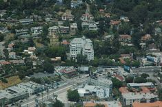 This is an aerial view over Hollywood taken on one of our private luxury helicopter tours of Los Angeles.  The building in the center is the Chateau Marmont hotel and bungalows on Sunset Boulevard.  It's a swinging destination that attracts young Hollywood celebs with its great bar and central location on the strip.