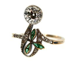1910 Edwardian Diamond & Emerald Engagement Ring | Tara Nash Jeweler - Edwardian jewel with a touch of Art Nouveau in platinum topped gold. $6,800.00
