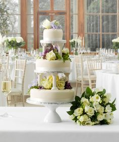 Three tier Marks & Spencer wedding cake decorated with fresh flowers