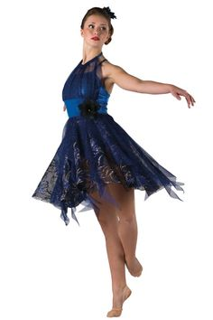 Style# 17381 FIRE AND ICE - ROYAL  Foil printed spandex leotard with glitter printed mesh overlay and attached strip skirt. Attached silver/color glitter printed black mesh skirt. Spandex binding straps and flower trim. Headpiece included. SC-XXLA