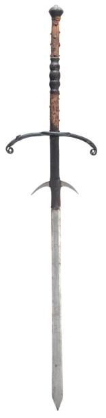 A German two-hand Processional sword, early 17th century. With long near-flat blade widening slightly towards a short spear point, an orb mark inlaid in latten on one side, long ricasso formed with a pair of slender forward-curved lugs and retaining its original leather covering over wooden fillets, blackened iron hilt of bars of diamond section.  original leather covering. L. overall: 173.5 cm - L. blade: 125 cm - W.: 37 cm.
