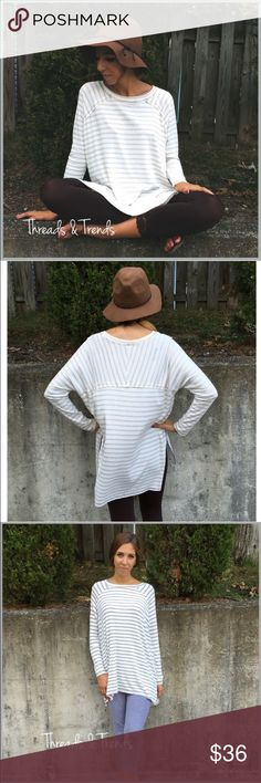 Long Sleeve Striped Tunic BELL SLEEVE LACE UP V-NECK BLOUSE  PRODUCT DESCRIPTION  • long bell sleeves • v-neckline w/lace up detailing • leaf print all over • relaxed, easy fit • soft, breathable material  Material Content: Rayon Tops Tunics