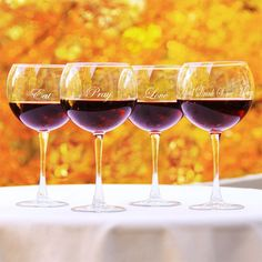 Set of 4  red wine glasses with script motifs.  Product: 4-Piece wine glass setConstruction Material: Glass...